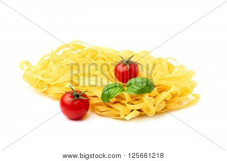 Raw pasta and tomatoes with basil.Isolated on white background.