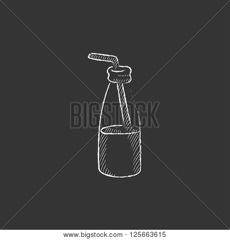 Glass bottle with drinking straw. Drawn in chalk icon.