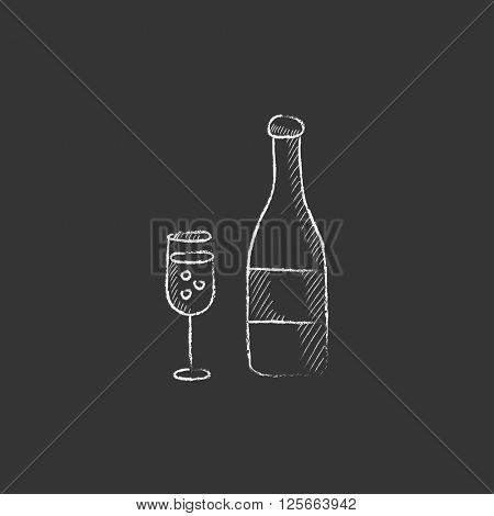 Bottle of champaign and glass. Drawn in chalk icon.