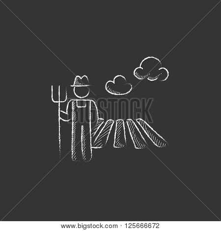 Farmer with pitchfork. Drawn in chalk icon.