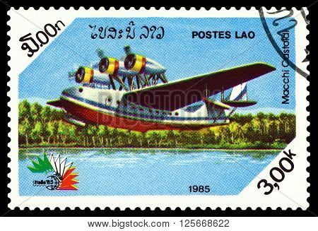 STAVROPOL RUSSIA - MARCH 30 2016: A stamp printed in Laos shows Macchi-Castoldi MC.100 Transport- passenger flying boat Italy 1938 cirka 1985