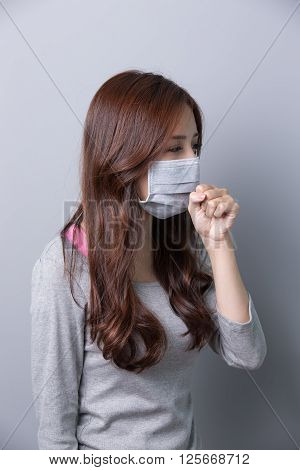 A Woman wears a mask and coughing illnessprofie asian beautygray background