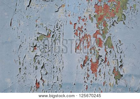 Metal texture with scratches and cracks, cracked paint, blue, green, red