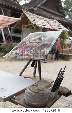 CHIANG MAI, THAILAND - APRIL 13: The painting of ancient lanna house at the ancientlanna house 140 years in water festival in Chiang Mai Thailand on April 13 2016.