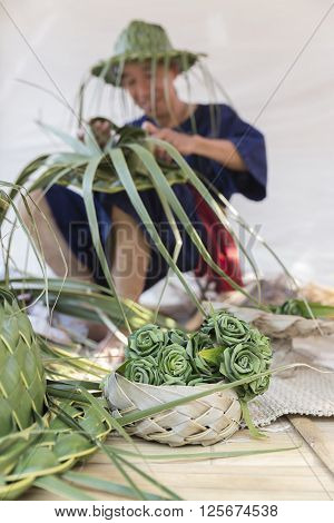 Artisan Weaving Palm Leaf For Making Hat