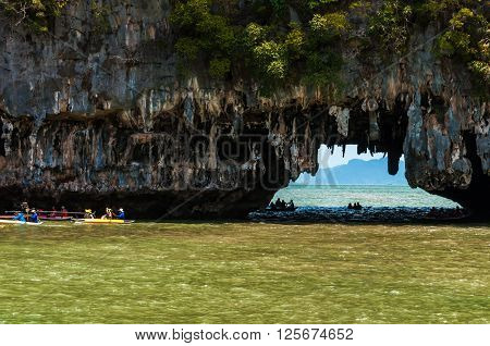 Tourists visit the limestone caves in the islands called Tham lod near Phuket. This is a popular tourist destination and the limestone rocks caves can only be entered from the sea with canoes.