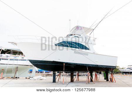 White small motor boat at dry shipyard for maintenance in Phuket Thailand