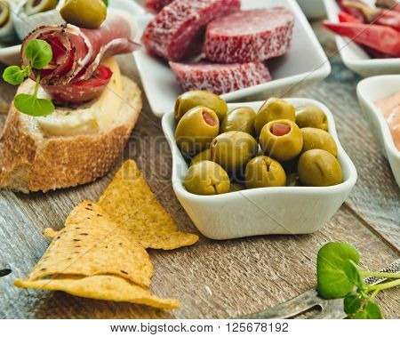 National Spanish tapas on a wooden background
