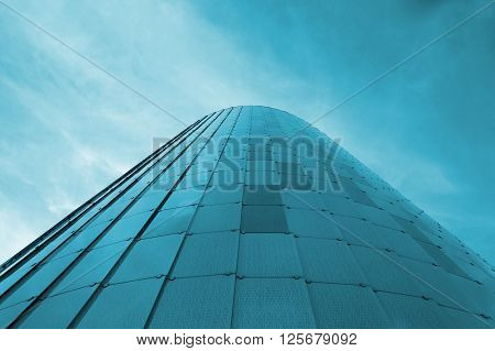 Low view image. Modern glass building skyscrapers over blue bright clear sky. Copy space for Publisher's text.