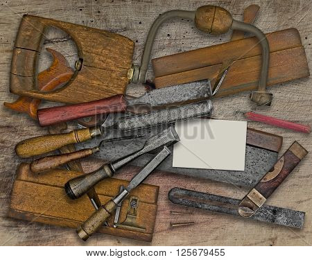 vintage woodworking tools over wooden bench business card for your text