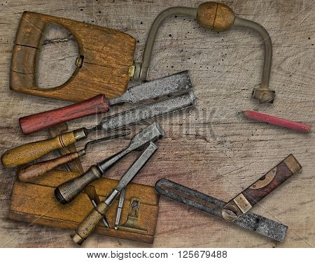 vintage woodworking tools over wooden bench space for your text