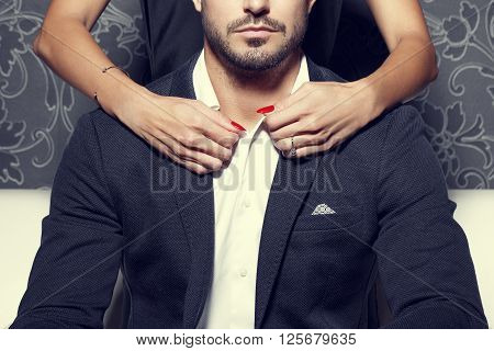 Woman hands undress sexy macho rich man