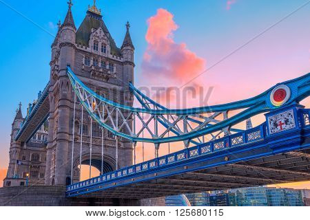 London, UK - March 31, 2016 - Tower Bridge and St. Katharine Pier against pink sunset sky
