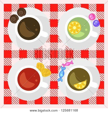Set of coffee and tea cups top view on a checkered tablecloth surface. Coffee cup, green tea, black tea and red hibiscus tea. Breakfast hot drinks.