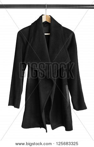 Black cashmere coat on clothes rack isolated over white