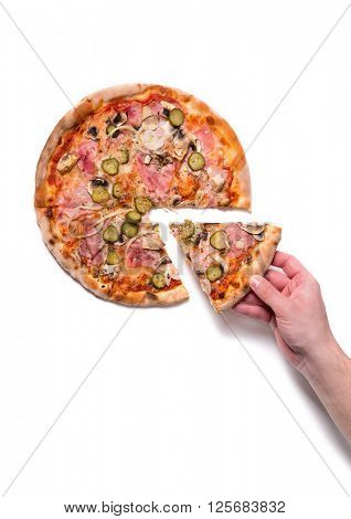 Male hand picking pizza slice, top view isolated on white background
