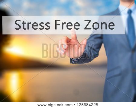 Stress Free Zone - Businessman Hand Pressing Button On Touch Screen Interface.