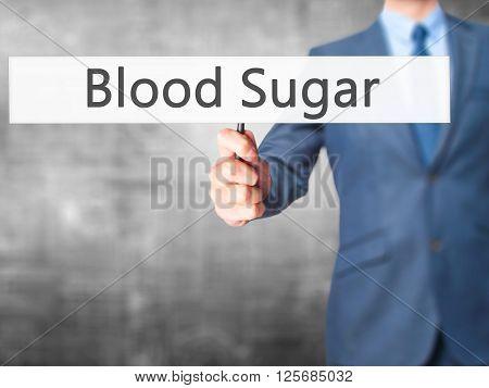 Blood Sugar - Businessman Hand Holding Sign