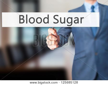 Blood Sugar - Businessman Hand Holding Sign