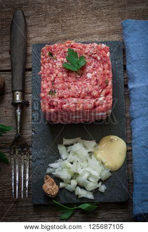 fresh beef steak tartare served on black tray
