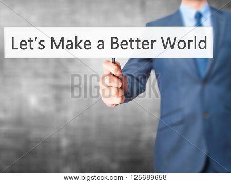 Let's Make A Better World - Businessman Hand Holding Sign
