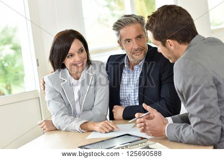 Mature couple meeting with realtor
