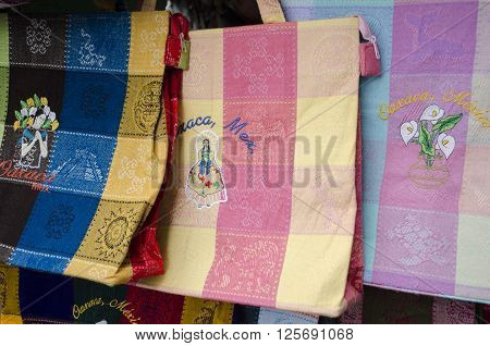 Colorful traditional textile bags for sale in Oaxaca, Mexico