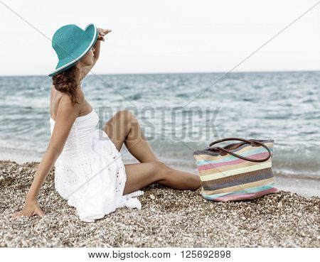 Woman relaxing at the seaside. Vintage style.