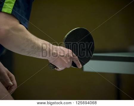 table tennis player waiting for the ball, closeup