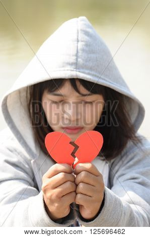 Sad Girl Praying to Reconcile from Red Broken Heart
