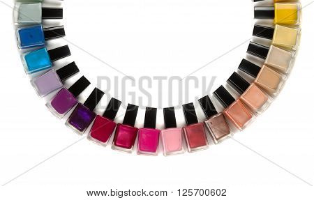 Bottles with nail polish arranged in a semicircle. Isolate on white background.