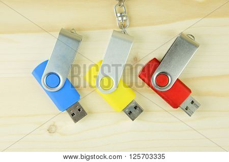 USB flash drive on the wooden background
