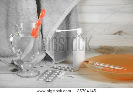 The image of medicines on a wooden background
