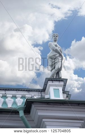 Sculpture on a roof of the building of the Winter Palace in St. Petersburg, Russia