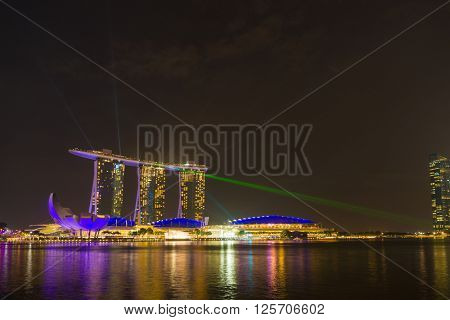 SINGAPORE CITY, SINGAPORE - FEBRUARY 19, 2016: Marina Bay Sands at night during Light and Water Show 'Wonder Full' . It opened on 27 April 2010. Singapore on FEBRUARY 19, 2016