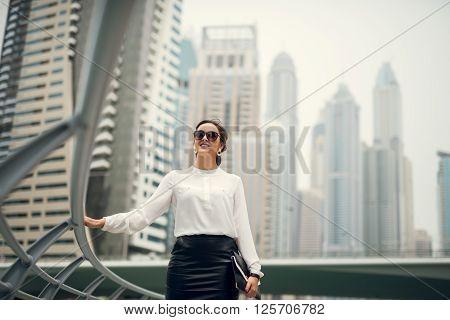 Elegant business woman enjoying a business trip.