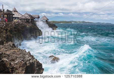 View of big waves at  Crystal Cove small island near Boracay island in the Philippines