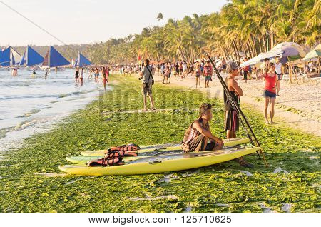 BORACAY PHILIPPINES - 13 FEBRUARY 2016: tourists and everyday life in Boracay - Exclusive destination islands in Philippines - Travel concept with white sand beach and blue ocean in south east Asia