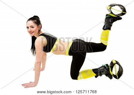 smiling young woman brunette with long hair in a kangoo jumps shoes doing exercises. Isolated on white background in studio