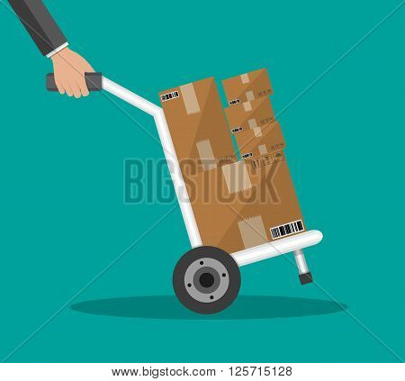 Metallic hand truck. delivery. hand truck icon. hand truck with brown boxes. vector illustration in flat design on green background