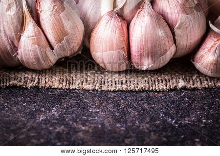 Garlic Bulbs With Garlic Cloves On Wooden Table,soft Focus