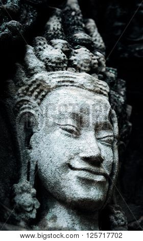 Statue of woman on the wall in ancient temple in Thailand. Concept of buddhism. Religion concept