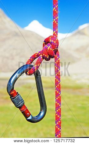 Climbing equipment - carabiner and rope. Extreme sport concept