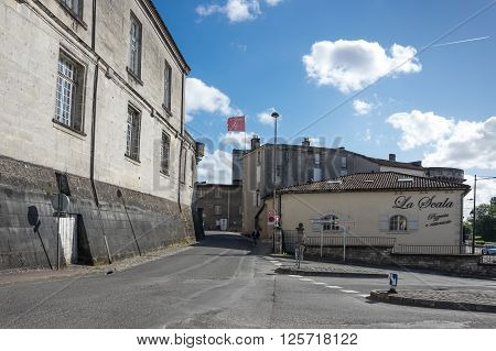 COGNAC FRANCE - MAY 06 2015: Old houses in french town Cognac. The town gives its name to one of the world's best-known types of brandy