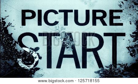 Abstract film leader frame macro with the text 'Picture Start'. High resolution macro