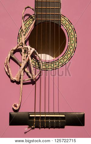 Violet guitar for children with treble clef closeup