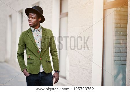 Close Up Fashion Portrait Of Black African American Man On Green Velvet Jacket And Black Hat Walking