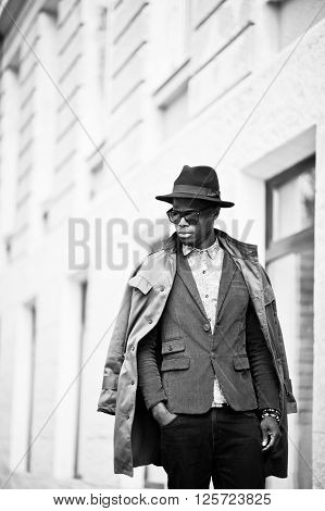 Fashion Portrait Of Black African American Man On Green Velvet Jacket, Black Hat And Coat Cloak On H