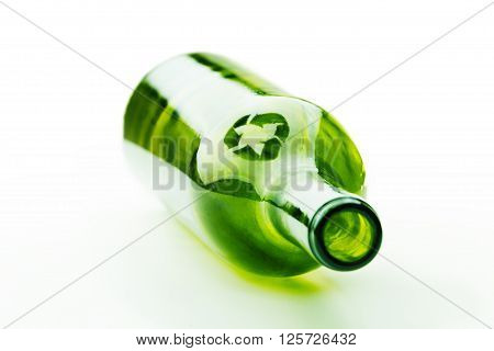 Empty green glass wine bottle with recycle sign  isolated on white background