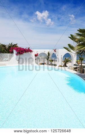 The swimming pool near beach Santorini island Greece